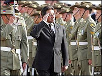 President Musharraf salutes a guard of honour in Parliament House, Canberra