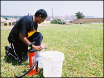 A Durban resident collecting pollution samples, BBC