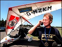 British pilot Colin Bodill receives congratulations over the telephone from UK Prime Minister Tony Blair after flying to Sydney