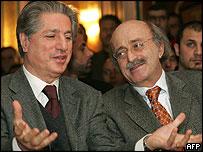 Former president Amine Gemayel talks to Druze leader Walid Jumblatt