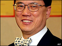 Donald Tsang,former acting chief executive, smiles at a election office in Hong Kong Wednesday, June 15, 2005.
