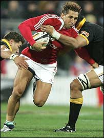 Lions centre Gavin Henson takes on the Wellington defence