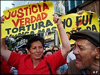 Anti-Pinochet demonstrators march in Santiago