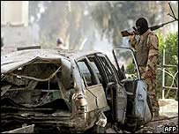 A member of Iraq's National Guard secures the site of the blast