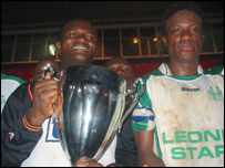 Sierra Leone's Mohamed Kallon (right) with the Peace trophy