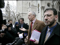 Families solicitor Phil Shiner and his researcher Mazin Younis outside the Royal Courts of Justice