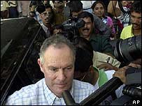 Greg Chappell is mobbed by the media in Mumbai