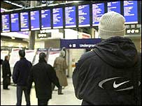 Man looks at a timetable
