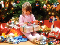 A girl unwrapping a present