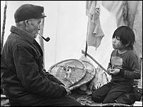 Innu man and boy. Copyright: Survival International
