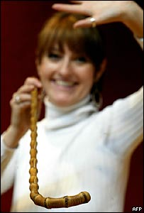 Katherine Williams, a Christies auction house employee, holds up Charlie Chaplin's bamboo cane