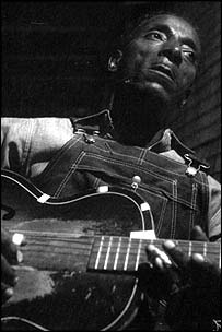 Fred McDowell, photographed by Alan Lomax in 1959. (Alan Lomax Archive)