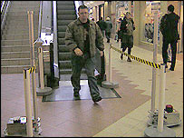 Man walks through Hammersmith metal detectors