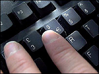 Person typing on a computer keyboard