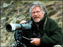 Bill Oddie with birdwatching monocular