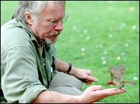 Bill Oddie with a robin