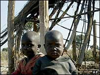Children sitting in front of demolished shack near Harare