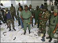 Former soldier Sgt Remissainthe Ravix, centre, in Aristide's abandoned house in Tabarre, Port-au-Prince on Wednesday
