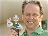 Animator Nick Park with claymation model of Wallace, from Wallace And Gromit