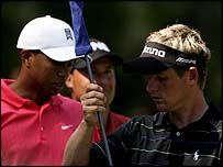 Luke Donald (right) with playing partners Tiger Woods and Chris DiMarco