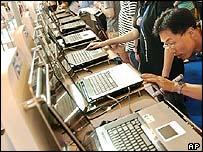 Man examining a laptop computer