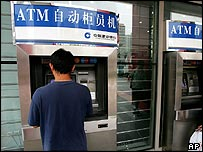A man withdrawing money from an ATM of China Construction Bank