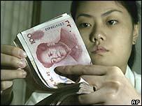 Bank teller counting yuan