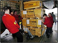 Oxfam volunteers loading aid onto a plane