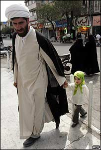 Cleric emerges from polling station with his daughter in Qom