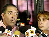 Dissident's son Roberto Quinones, accompanied by his Argentine wife, talks to reporters Thursday in Buenos Aires