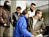 Arrest of hostage-takers (right and second from left)
