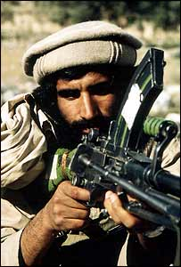 Machine-gunner with the mujahideen (photo: Jason Elliot)