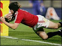 Ryan Jones crashes over to score the Lions' second try