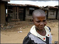 A child walks in front of looted shops in Kanyabayonga, DR Congo