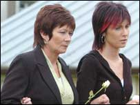 Bernie O'Connor walks behind the coffin of her son, with his partner Leona