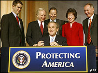 President Bush (C) signs the Intelligence Reform and Terrorism Prevention Act of 2004 in Washington DC