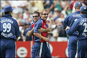 Paul Collingwood is congratulated by his team-mates