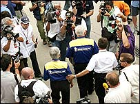 Michelin officials are bombarded by questions in the Indianapolis pit lane