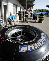 A Michelin racing tyre sits behind the garage area