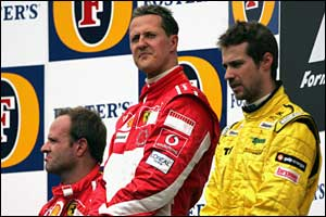 (L-R) Rubens Barrichello, Michael Schumacher and Tiago Monteiro