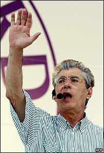 Umberto Bossi waves to supporters in Pontida