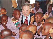 Mr Wolfowitz visiting a children's orphanage in Kigali, the Rwandan capital