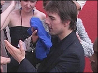 Tom Cruise being towelled down after he was squirted at a London premiere (PA multimedia)