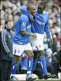 Clinton Morrison (left) is congratulated on his goal by fellow scorer Emile Heskey
