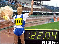 Kozo Haraguchi, 95, celebrates after setting the new world record of the 100m dash, 95-99 year-old class, in 22.04 seconds during the masters athletic in Miyazaki, southern Japan, 19 June 2005.