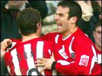 Sheffield United's Andy Liddell celebrates the equalizing goal with match-winner Andy Gray