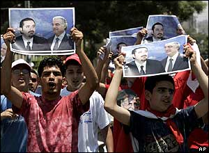 Supporters hold up posters of assassinated politician Rafik Hariri and his son Saad, who was standing in the election