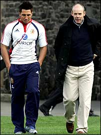 A downcast Gavin Henson chats to Lions coach Sir Clive Woodward after training