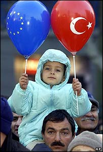 A child holds balloon carrying the Turkish and EU emblems in Ankara