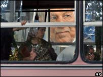 Election poster of former Iranian President Akbar Hashemi Rafsanjani seen through a Tehran bus